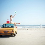 kate-spade-ad-campaign-beach-woman-on-yellow-car-590sc031910